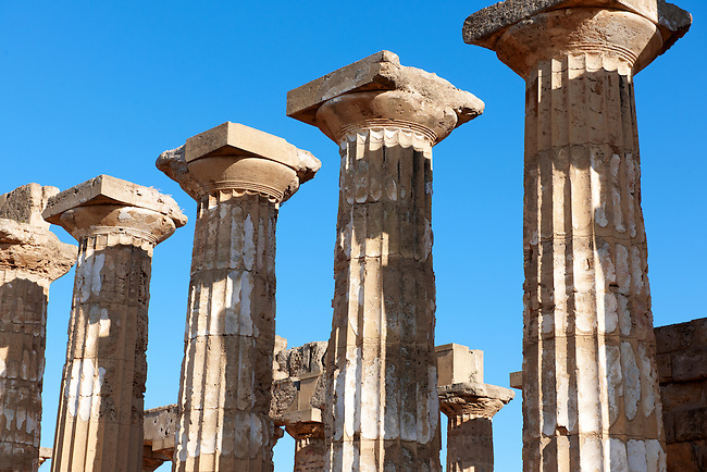 Greek Dorik columns at the  ruins of Temple F at Selinunte, Sicily photography, pictures, photos, images & fotos. 68