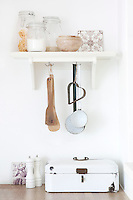 The kitchen is decorated with a few antique objects add personality to the room