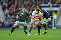 Jonny May of England is tackled by Adriaan Strauss and Eben Etzebeth of South Africa during the QBE International match between England and South Africa at Twickenham Stadium on Saturday 15th November 2014 (Photo by Rob Munro)