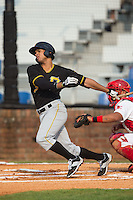 Trae Arbet (7) of the Bristol Pirates follows through on his swing against the Johnson City Cardinals at Howard Johnson Field at Cardinal Park on July 6, 2015 in Johnson City, Tennessee.  The Pirates defeated the Cardinals 2-0 in game one of a double-header. (Brian Westerholt/Four Seam Images)