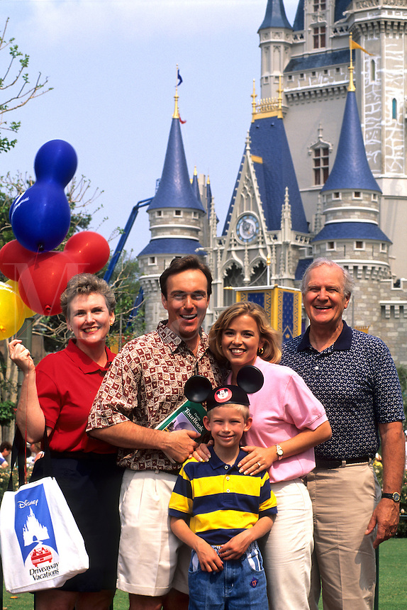 Family of three generations at Cinderellas Castle at Disney World in Orlando Florida