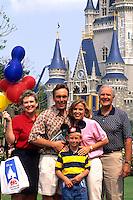 Family of three generations at Cinderellas Castle at Disney World in Orlando Florida