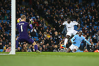 Bafetibis Gomis scores his sides first goal during the Barclays Premier League Match between Manchester City and Swansea City played at the Etihad Stadium, Manchester on 12th December 2015