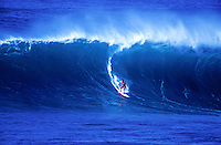 A surfer takes off on a giant wave at world famous Pipeline beach at the North Shore, Oahu.