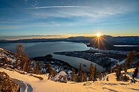 The sun cresting the Tahoe basin from above Emerald Bay, California.