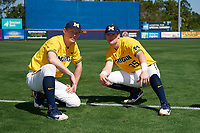 Michigan Wolverines Jimmy Kerr (15) and Brock Keener (35) before a game against Army West Point on February 17, 2018 at Tradition Field in St. Lucie, Florida.  Army defeated Michigan 4-3.  (Mike Janes/Four Seam Images)