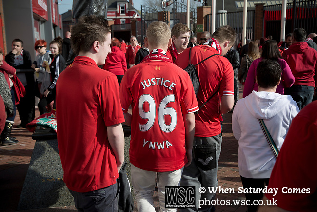 Fans congregate after the 25th anniversary memorial service to the 1989 Hillsborough disaster at Liverpool Football Club's Anfield Stadium. The Hillsborough stadium disaster led to 96 Liverpool football fans losing their lives in a crush at an FA Cup semi final tie against Nottingham Forest. The families of the victims campaigned against the original verdict of the incident and were rewarded with a new inquiry held in 2014 into events at the match at Hillsborough. Photo by Colin McPherson.