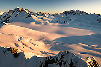 Sunset on Franz Josef Glacier neve with Mount Tasman and Aoraki Mount Cook in distance, Westland Tai Poutini National Park, West Coast, UNESCO World Heritage Area, New Zealand, NZ