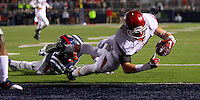 11/7/15<br /> Arkansas Democrat-Gazette/STEPHEN B. THORNTON<br /> Arkansas' Drew Morgan leaps over  Ole Miss's Cameron Ordway (28) on his way to scoring Arkansas' fifth touchdown in the fourth quarter during  Saturday's game in Oxford, Miss. Morgan had three TD's.
