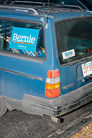 Campaign stickers and signs are seen on a vehicle outside a campaign rally for Democratic presidential candidate and Vermont senator Bernie Sanders at Hampshire Hills Athletic Club in Milford, New Hampshire, on Tue., Feb. 4, 2020. The  event started around 7pm and was the first event Sanders held after the previous day's Iowa Caucuses. The results of the caucuses were unknown until the Democratic party released partial numbers at 5pm, showing Sanders and former South Bend, Ind., mayor Pete Buttigieg both as frontrunners.