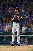 Cleveland Indians pitcher Andrew Miller (24) gets ready to deliver a pitch in the sixth inning during Game 3 of the Major League Baseball World Series against the Chicago Cubs on October 28, 2016 at Wrigley Field in Chicago, Illinois.  (Mike Janes/Four Seam Images)