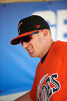 Norfolk Tides first baseman Chris Parmelee (41) in the dugout before a game against the Rochester Red Wings on May 3, 2015 at Frontier Field in Rochester, New York.  Rochester defeated Norfolk 7-3.  (Mike Janes/Four Seam Images)