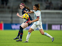 ORLANDO, FL - FEBRUARY 24: Rose Lavelle #16 of the USWNT fights for the ball with Vanesa Santana #5 of Argentina during a game between Argentina and USWNT at Exploria Stadium on February 24, 2021 in Orlando, Florida.