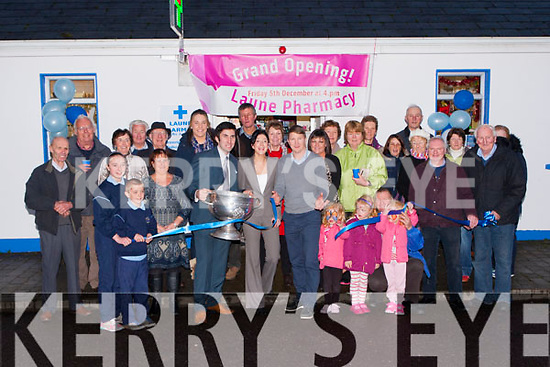 Mike Frank Russell cuts the tape to officially open Padraig and Aine O'Connor Laune Pharmacy in Killorglin on Friday