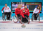 Sochi, RUSSIA - Mar 10 2014 -  Mark Ideson, Dennis Thiessen and Ina Forrest look on as USA takes a shot during Canada vs USA in Wheelchair Curling round robin play at the 2014 Paralympic Winter Games in Sochi, Russia.  (Photo: Matthew Murnaghan/Canadian Paralympic Committee)