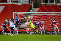 16th February 2021; Bet365 Stadium, Stoke, Staffordshire, England; English Football League Championship Football, Stoke City versus Sheffield Wednesday; Goalkeeper Angus Gunn of Stoke City makes a save from a crossed ball