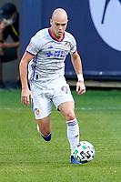 CHICAGO, UNITED STATES - AUGUST 25: Andrew Gutman #96 of FC Cincinnati dribbles the ball during a game between FC Cincinnati and Chicago Fire at Soldier Field on August 25, 2020 in Chicago, Illinois.