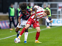 Bolton Wanderers' Peter Kioso competing with Stevenage's Arthur Read (right) <br /> <br /> Photographer Andrew Kearns/CameraSport<br /> <br /> The EFL Sky Bet League Two - Stevenage v Bolton Wanderers - Saturday 21st November 2020 - Lamex Stadium - Stevenage<br /> <br /> World Copyright © 2020 CameraSport. All rights reserved. 43 Linden Ave. Countesthorpe. Leicester. England. LE8 5PG - Tel: +44 (0) 116 277 4147 - admin@camerasport.com - www.camerasport.com