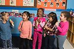 Education Preschool 4 year olds pretend play group of girls singing and using blocks or drumsticks as microphones