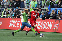 SEATTLE, WA - NOVEMBER 10: Joevin Jones #33 of the Seattle Sounders FC challenges Jonathan Osorio #21 of Toronto FC for the ball during a game between Toronto FC and Seattle Sounders FC at CenturyLink Field on November 10, 2019 in Seattle, Washington.