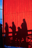 Shadows of people in stnd at baseball game