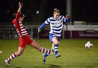 20140221 - OOSTAKKER , BELGIUM : Gent Pauline Windels (r) pictured trying to escape tackling Antwerp Annelies Van Loock (l) during the soccer match between the women teams of AA Gent Ladies  and RAFC Antwerp Ladies , on the 19th matchday of the BeNeleague competition Friday 21 February 2014 in Oostakker. PHOTO DAVID CATRY