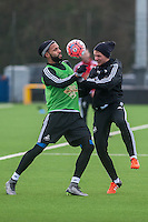 Wednesday  06 January 2016<br /> Pictured L-R: Kyle Bartley and Stephen Kingsley of Swansea in action during training<br /> Re: Swansea City Training session at the Fairwood training ground, Swansea, Wales, UK