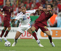 French forward (12) Thierry Henry fights for the ball with Portuguese defender (16) Ricardo Carvalho.  France defeated Portugal, 1-0, in their FIFA World Cup semifinal match at FIFA World Cup Stadium in Munich, Germany, July 5, 2006.