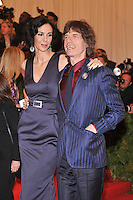 L'Wren Scott and Mick Jagger at the 'Schiaparelli And Prada: Impossible Conversations' Costume Institute Gala at the Metropolitan Museum of Art on May 7, 2012 in New York City. ©mpi03/MediaPunch Inc.