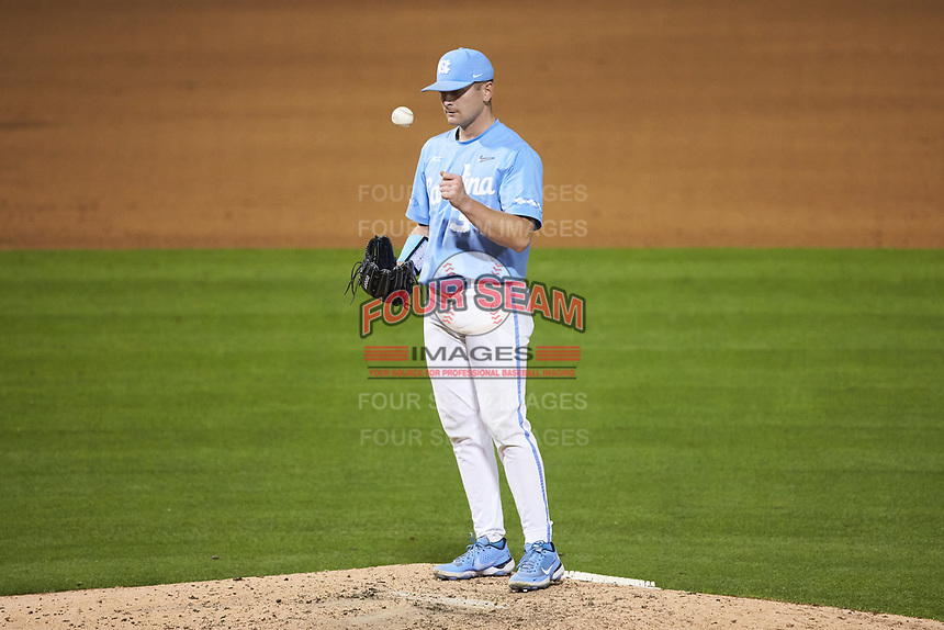 North Carolina Tar Heels relief pitcher Caden O'Brien (34) flips the ball in the air during the game against the South Carolina Gamecocks at Truist Field on April 6, 2021 in Charlotte, North Carolina. (Brian Westerholt/Four Seam Images)