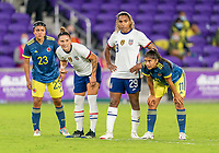 ORLANDO, FL - JANUARY 22: Nancy Acosta #23 and Catalina Usme #11 of Colombia defends Ali Krieger #11 and Catarina Macario #29 of the USWNT during a game between Colombia and USWNT at Exploria stadium on January 22, 2021 in Orlando, Florida.