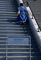 Montreal (Qc) Canada - File Photo - A catholic woman goes atop the Saint-Joseph Oratory