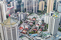 Urban Growth.  Singapore City View from Top of Ion Mall.  Highrise Apartment and Office Buildings Surround Lowrise Construction of an Earlier Era.