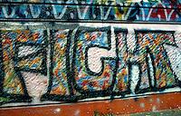Milano, 1990.Un graffito sul muro esterno del CS Mandragora in Ple Aspromonte..Foto Livio Senigalliesi