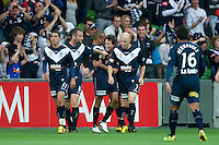 MELBOURNE, AUSTRALIA - DECEMBER 11: Victory players celebrate Robbie Kruse's goal during the round 18 A-League match between the Melbourne Heart and Melbourne Victory at AAMI Park on December 11, 2010 in Melbourne, Australia. (Photo by Sydney Low / Asterisk Images)