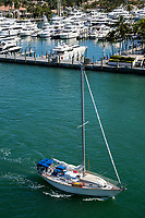 Ft. Lauderdale, Florida.  Sail Boat Passing by the Hyatt Marina on the Intracoastal waterway.