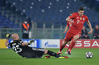 Robert Lewandowski of FC Bayern Munchen past Manuel Jose Pepe Reina of SS Lazio and goes to score the goal of 0-1 during the Champions League round of 16 football match between SS Lazio and Bayern Munchen at stadio Olimpico in Rome (Italy), February, 23th, 2021. Photo Andrea Staccioli / Insidefoto