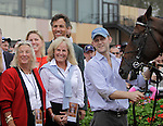 Charlotte Weber, left, joins To Honor and Serve in the winner's circle after the Pennsylvania Derby at  Parx Racing in Bensalem, PA, September 24, 2011.  The horse is owned by Weber's Live Oak Plantation. Jockey is Jose Lezcano, trainer is Bill Mott. (Joan Fairman Kanes/Eclipse Sportswire)