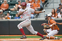 Stanford OF Austin Wilson (30) follows through against the Texas Longhorns on March 4th, 2011 at UFCU Disch-Falk Field in Austin, Texas.  (Photo by Andrew Woolley / Four Seam Images)