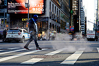 NEW YORK - NEW YORK - APRIL 13: A man walks trough the sewer smoke at Times Square on April 13, 2021 in New York. More than 300 corporates including Google and Mc Donalds are pushing the Biden administration to almost double the United States target for cutting the planet warming emissions, ahead global summit on climate change in 2021. (Photo by John Smith/VIEWpress)