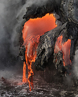 Dripping Lava Rock: Lava flows off the face of this lava bench, where ocean meets fire, Hawai'i Volcanoes National Park, Big Island.
