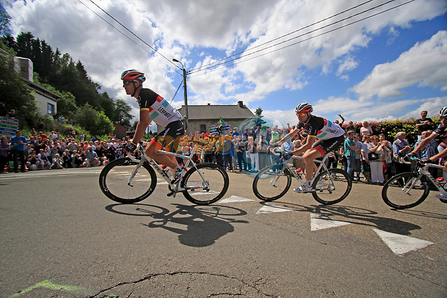 The peloton led by Yaroslav Popovytch (UKR), Jens Voigt (GER) and the rest of the Radioshack-Nissan team climbs the Cote De Lierneux during Stage 1 of the 99th edition of the Tour de France, running 198km from Liege to Seraing, Belgium. 1st July 2012.<br /> (Photo by Eoin Clarke/NEWSFILE)