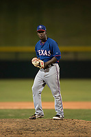 AZL Rangers relief pitcher Ediberto Encarnacion (31) prepares to deliver a pitch during an Arizona League game against the AZL Cubs 2 at Sloan Park on July 7, 2018 in Mesa, Arizona. AZL Rangers defeated AZL Cubs 2 11-2. (Zachary Lucy/Four Seam Images)