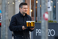 Pictured: A man with three pints of lager in Mumbles. Friday 16 April 2021<br /> Re: People enjoy an evening out after Covid-19 lockdown rules were relaxed, in Swansea Bay, Wales, UK.