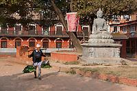 Nepal, Patan.  Newari Man Using Shoulder Pole (nol) to Carry a Load.