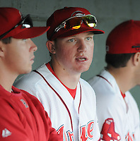 Ryan Westmoreland (24) of the Greenville Drive talks with teammates in the dugout at a game on Sept. 5, 2010, at Fluor Field at the West End in Greenville, S.C. Westmoreland, once a Top 10 prospect in the Red Sox organiztion, had surgery in March to remove a cavernous malformation on his brain stem, and faces a difficult recovery. He is not yet playing, but is working out with the Drive as part of his rehabilitation. Photo by: Tom Priddy/Four Seam Images
