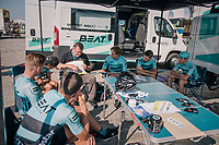 """outside (public?) pre-race strategy meeting for the Beat Cycling team<br /> <br /> Antwerp Port Epic 2018 (formerly """"Schaal Sels"""")<br /> One Day Race:  Antwerp > Antwerp (207 km; of which 32km are cobbles & 30km is gravel/off-road!)"""