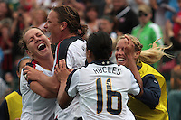 USWNT's Abby Wambach (20, ctr) celebrates with teammates Lauren Cheney (left, 19) and Angela Hucles (16) after scoring her 100th career goal in the second half. The U.S. Women's National Team defeated Canada 1-0 in a friendly match at Marina Auto Stadium in Rochester, NY on July 19, 2009.