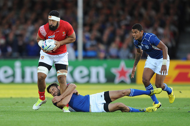 Danie Van Wyk of Namibia hangs onto Viliami Ma'afu for dear life during Match 20 of the Rugby World Cup 2015 between Tonga and Namibia - 29/09/2015 - Sandy Park, Exeter<br /> Mandatory Credit: Rob Munro/Stewart Communications