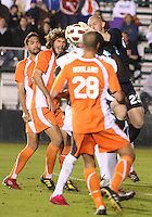 Eric Reed #23 Of the Carolina Railhawks pulls the ball off the head of Chris Nurse #8 of the Puerto Rico Islanders during the second leg of the USSF-D2 championship match at WakeMed Soccer Park, in Cary, North Carolina on October 30 2010. The game ended 1-1, Puerto Rico won on overall goals 3-1.